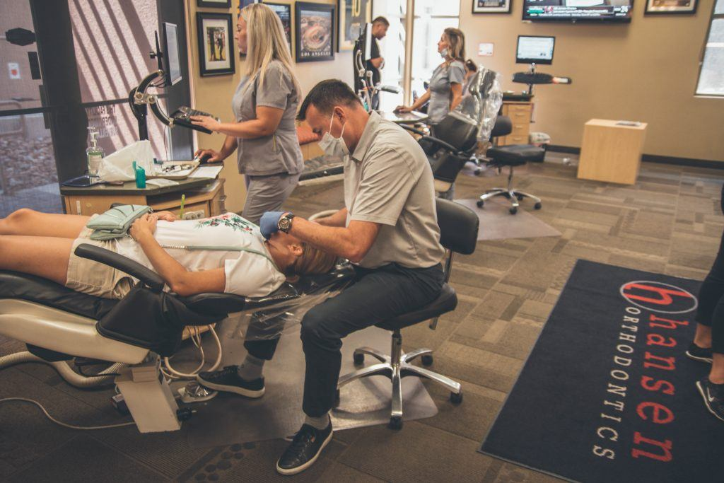 Dentist changing braces colors on a patient